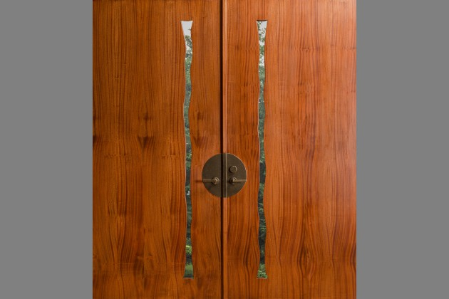 Custom sapele wood double entry doors with glass windows and bronze hardware