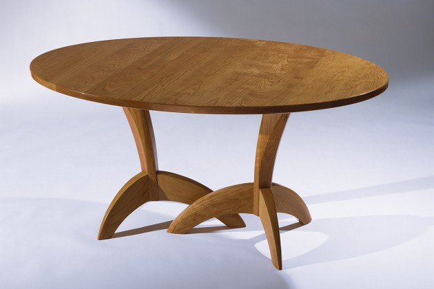 Expanding cherry wood dining table hand carved by Seth Rolland custom furniture design