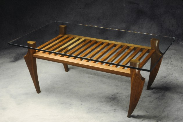 solid walnut and cherry coffee table with a glass top. Custom made in various sizes by Seth Rolland furniture