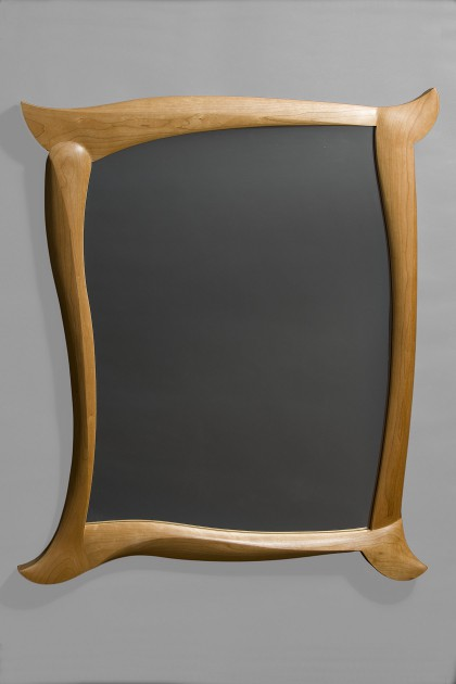 Cherry wood mirror with carved frame by Seth Rolland custom furniture design