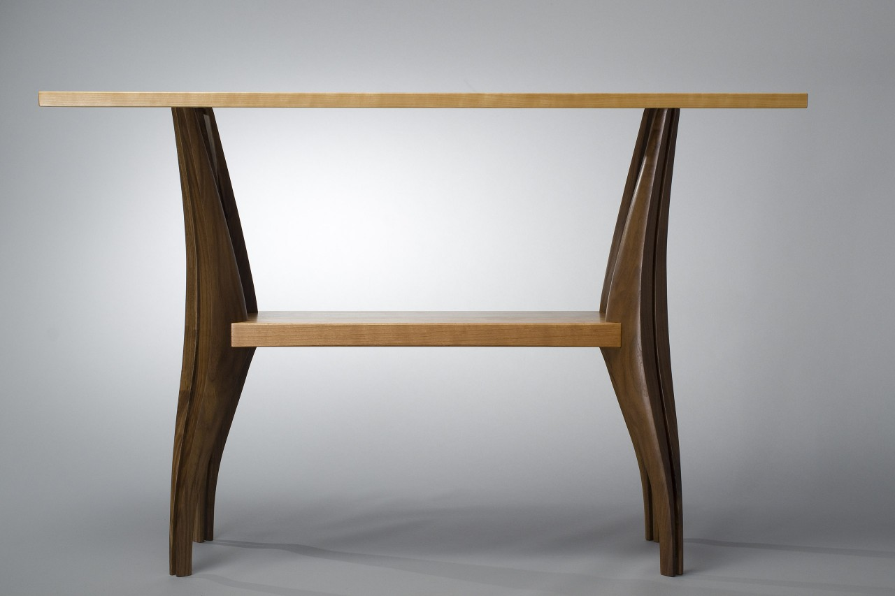 Low view of Gazelle hall table hand carved from walnut and cherry by Seth Rolland custom furniture design